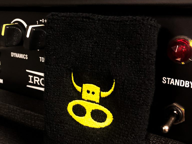 Wristband with cow logo embroidery.
